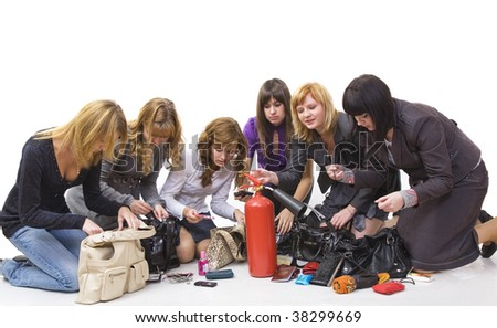 Six girls have opened the bags and spread various subjects