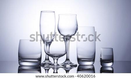 Six glasses on white background - stock photo