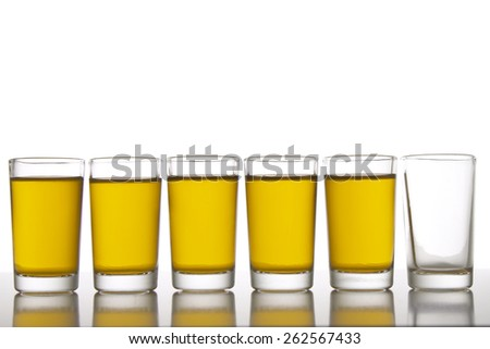 Six glasses, one empty