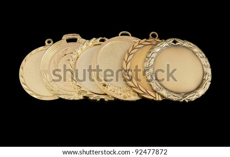 Six gold medals in a row isolated on black background - stock photo