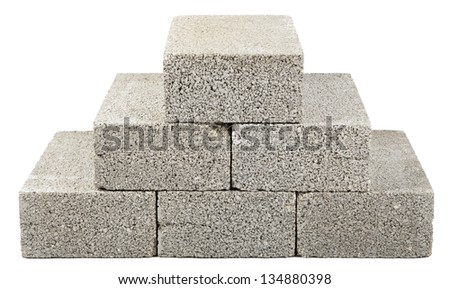 Six gray concrete construction blocks stacked together in the shape of a pyramid. Isolated on white background. - stock photo