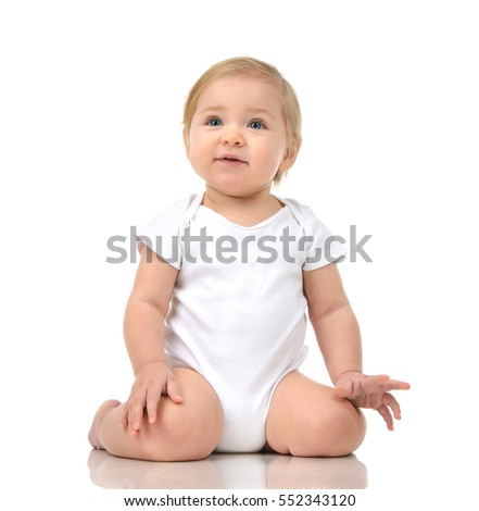 Six month Infant child baby toddler sitting and happy looking at the corner isolated on a white background