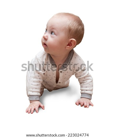 Six month old baby crawling on the carpet in the room. - stock photo