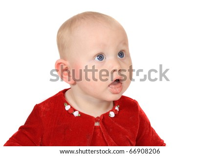 Six month old baby girl with big blue eyes and red velvet jacket on a white background