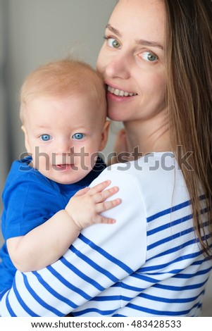 Six months old baby boy with his mother