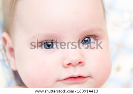 Six months old baby girl closeup portrait. Shallow depth of field
