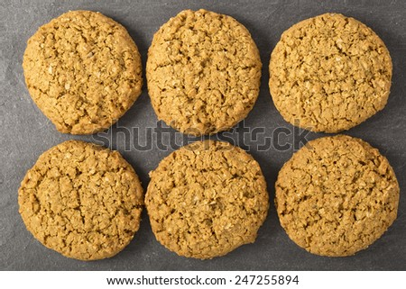 Six oatmeal cookies from directly above - stock photo