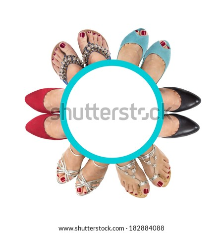 Six pairs of female legs on a white background. View from the top. - stock photo