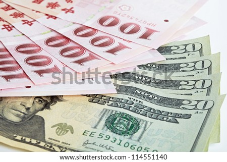 six piece of one hundred dollar of  New Taiwan Dollar cash and five piece of twenty  dollars of US case with white backuground close up - stock photo
