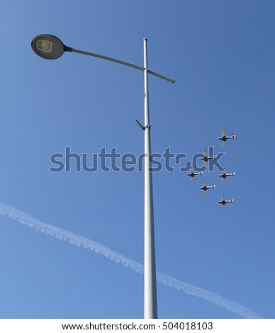 Six planes fly in formation above the street lamp Novi Sad, Serbia, 20th October 2016.