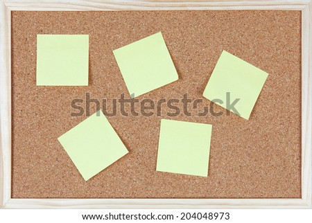 Six post-it notes sticked on corkboard.