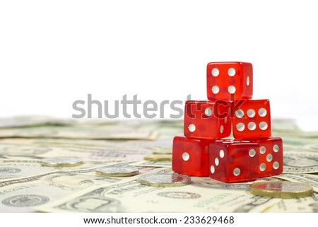 Six Red Dices Stacked on Top of Each Other on Money Background - stock photo