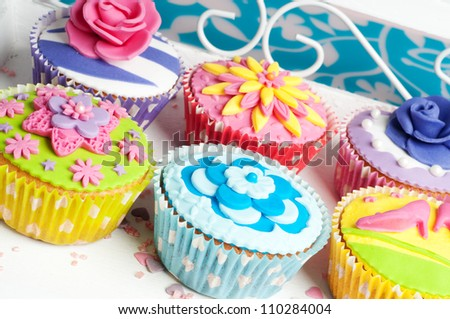 Six romantic colorful flower decorated party cupcakes for birthday or wedding - stock photo