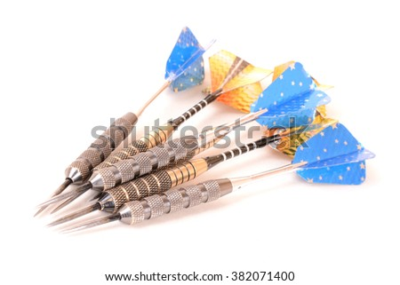 Six sport darts in blue and gold (focus on forefront). Image isolated on white studio background. - stock photo