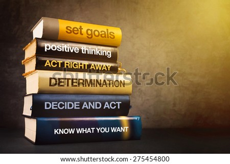 Six Steps to Business Success Literature, Mastering Business Management Concept with Stack of Published Books. - stock photo