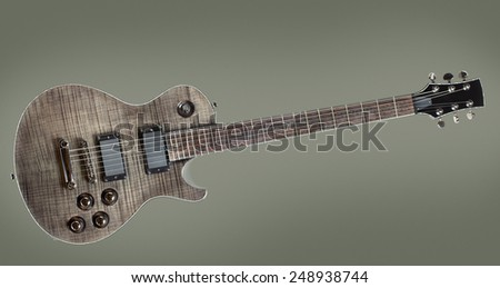 six-string black electric guitar, on gray background - stock photo