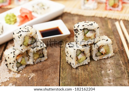 Six sushi pieces on the table with no plates - stock photo