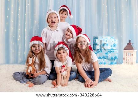 Six sweet kids, preschool children, having fun for christmas - stock photo