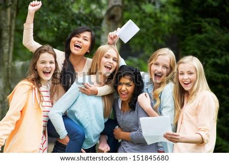 Six Teenage Girls Celebrating Successful Exam Results - stock photo