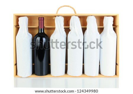 Six tissue wrapped wine bottles in a wooden crate with rope handle. Horizontal format isolated on white with reflection. One bottle is not wrapped. - stock photo