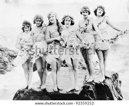 Six women posing at the beach - stock photo