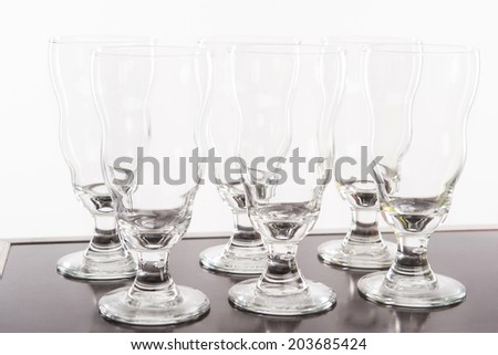 Six wonderful glasses of cocktails standing on the silver bar counter - stock photo
