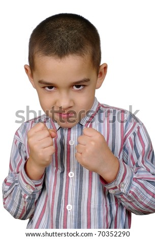 six year old Hispanic boy with fists raised ready to fight, isolated on white background - stock photo