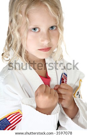 Six year old in taekwondo uniform and stance.