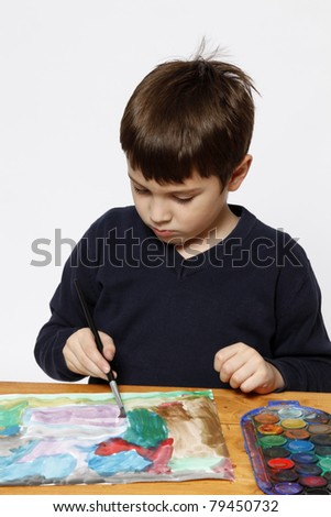 Six years boy practicing painting