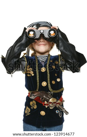 Six years girl wearing costume of pirate looking away through the binoculars at you, over white background