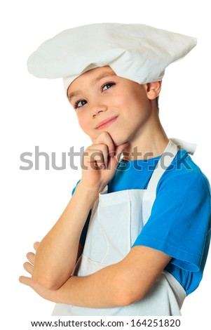 Six years old cook boy isolated on white - stock photo
