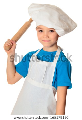 Six years old cook boy with rolling pin isolated on white