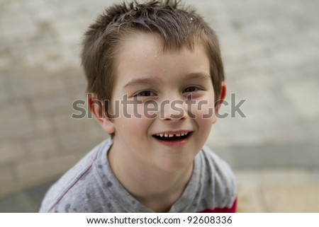 Six years old kid looking at camera, shot from above - stock photo