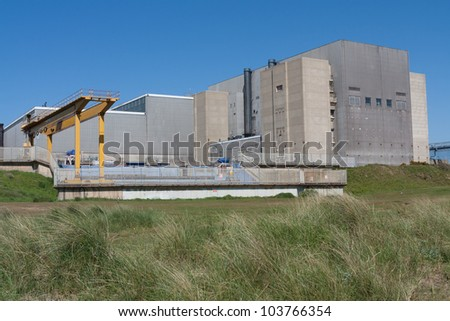 Sizewell A nuclear power station, stands out against a blue sky.. It is in the process of being decommissioned. - stock photo