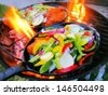 Sizzling healthy fajita chicken beef pork and veggie dinner barbecue grill cookout on a plate - stock photo