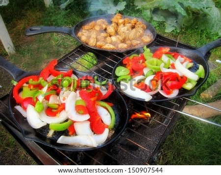 Sizzling healthy fajita chicken beef pork and veggie dinner barbecue grill cookout on a plate