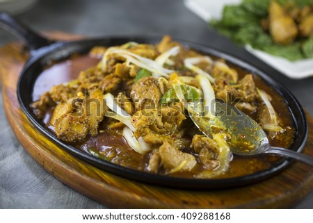Sizzling lemongrass chicken with jalapenos, turmeric and lettuce wraps - stock photo