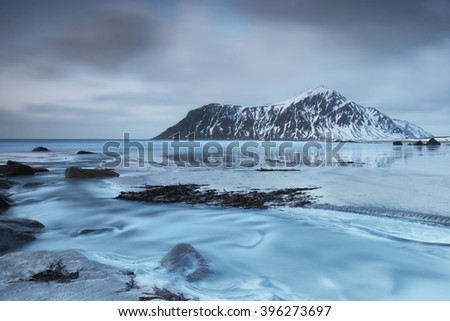 Skagsanden Beach in the Lofoten Islands, Norway in the winter on a cloudy day, Long time exposure