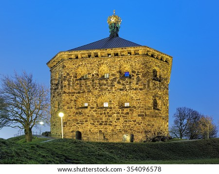 Skansen Kronan (the Crown Redoubt) on top of Skansberget hill of Gothenburg, Sweden in evening. The plate above the entrance reads: The Crown Redoubt erected in 1687-1700. - stock photo