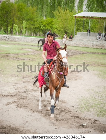 SKARDU, PAKISTAN - APRIL 18: An unidentified two man in a village in the south of Skardu, polo match on April 18, 2015 in Skardu, Pakistan with a population of more than 150 million people.