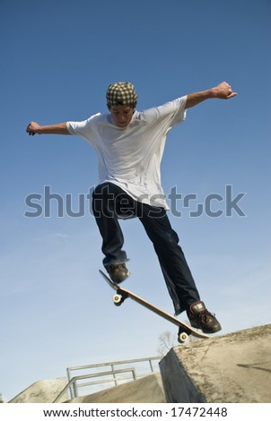 Skate board jump with board about to launch - stock photo