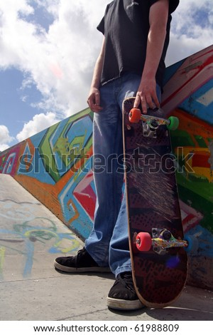 Skate Boarder holding his skate board in his hand at Limerick City Skate park