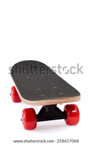 skateboard with red wheels on white background - stock photo
