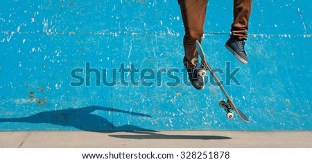 Skateboarder doing a skateboard trick - ollie - at skate park. Copy space. - stock photo