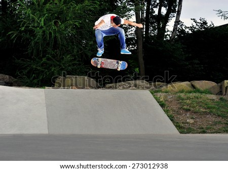 skateboarder flying high at the skate park. - stock photo