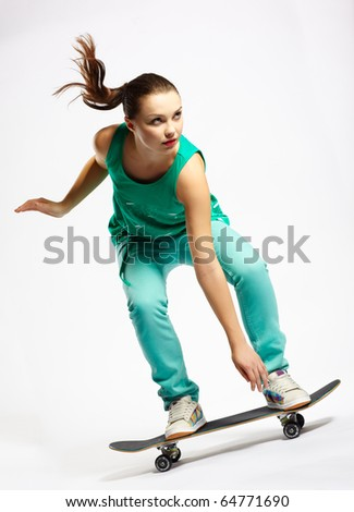 Skateboarder girl skating on skateboard with high speed