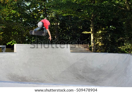 skateboarder having fun at the local skate park