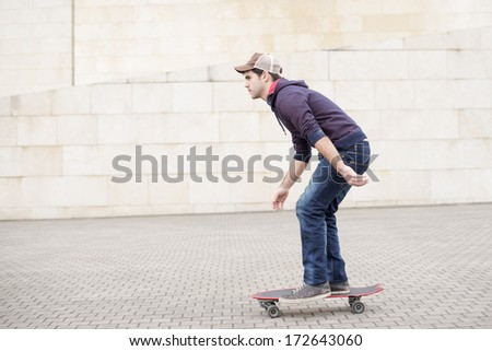 Skateboarder in action in the street.