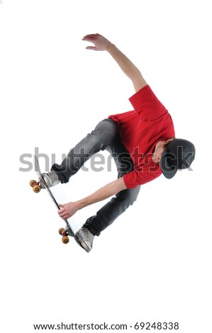 Skateboarder jumping isolated on white - stock photo
