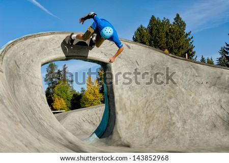 Skateboarder Rides over Arch - stock photo